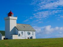 Obrestad lighthouse in Norway. stock photo