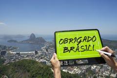 Obrigado Brasil Soccer Football Tactics Board Rio de Janeiro. Hands holding Obrigado Brasil Thank You Brazil soccer football tactics board and pen above skyline Stock Photo