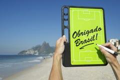Obrigado Brasil Soccer Football Tactics Board Rio de Janeiro. Hands holding Obrigado Brasil Thank You Brazil soccer football tactics board and pen at Ipanema Royalty Free Stock Images