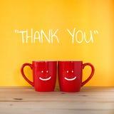 Obrigado exprimir Dois xícaras de café e suportes junto imagem de stock