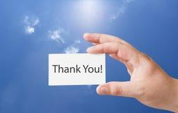 Obrigado texto no cartão do Livro Branco imagens de stock