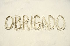 Obrigado Thank You Message in Sand Royalty Free Stock Images