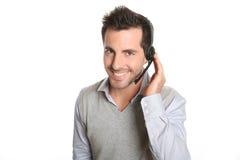 Obsługa klienta opowiada klient z słuchawki obraz stock