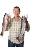 Obsługuje mienia dwa wielkiej świeżej ryba - pstrąg w rękach obrazy royalty free