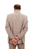 Obsługuje w kostiumu obracał jego z powrotem, brać zamyśleniu jego nadgarstek fotografia stock