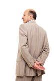 Obsługuje w kostiumu obracał jego z powrotem, brać zamyśleniu jego nadgarstek obrazy stock