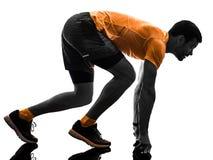 Obs?uguje biegacza dzia?aj?cego jogger jogging odosobnionego sylwetka bielu plecy obraz royalty free