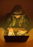 Obscure criminal man is trying to hack the system Stock Photos