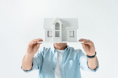 Obscure view of man showing house model Royalty Free Stock Images