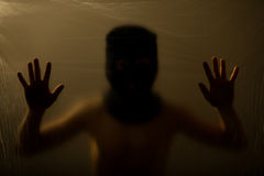 Obscured child with covered face touching surface Royalty Free Stock Photography