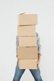 Obscured man carrying boxes Stock Photo