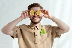 Obscured view of smiling man. With lemon pieces and savoy cabbage leaf in pocket vegan lifestyle concept royalty free stock photos