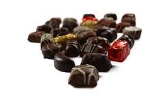 Obscuridad y caramelos del chocolate con leche Fotografía de archivo libre de regalías