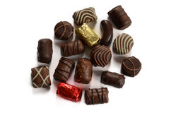 Obscuridad y caramelos del chocolate con leche Imagen de archivo