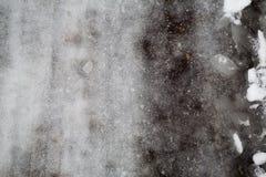 Obscuridade de derretimento da neve de Groung - cinza Foto de Stock