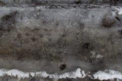 Obscuridade de derretimento da neve de Groung - cinza Fotos de Stock