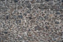 Obscuridade do un da textura da parede de pedra - cinza Fotos de Stock