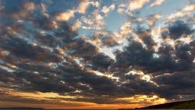 A obscuridade nubla-se o por do sol Imagem de Stock