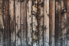 A obscuridade velha do vintage mancha o fundo de madeira das pranchas Fotos de Stock