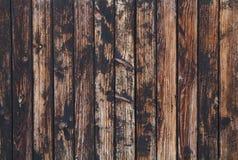 A obscuridade velha do vintage mancha o fundo de madeira das pranchas Fotografia de Stock