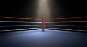 Obscurité éclairée par des projecteurs faisante le coin de boxe Photos stock