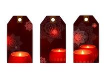 Obscurité de flamme de bougies d'étiquette Photographie stock