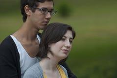 Observação do adolescente e da menina Imagens de Stock Royalty Free