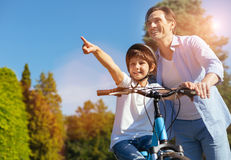 Observant emotional child pointing at something exciting Stock Photo
