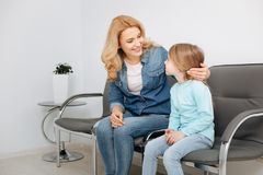 Observant great mom calming her daughter. It will be fine. Beautiful supportive young mother looking at her child and making sure she not being very nervous Stock Photos