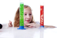 Observant pretty girl watching reaction. Of reagents, close-up Stock Image