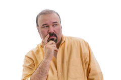 Observant speculative man standing thinking. Observant speculative middle-aged man with a goatee standing thinking and looking to the right side of the frame Stock Photography