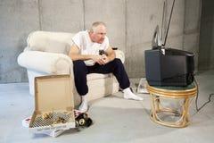 Observateur enthumansiaste de TV Image libre de droits