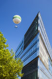Observation balloon in Hamburg, Germany, editorial. Hamburg, Germany - July 7: A hot-air balloon used as observation point for tourists next to the Stock Images
