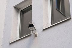 Observation camera with pigeon protection with steel spikes Royalty Free Stock Photography