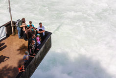 Observation deck, full of tourists, on Rhinfall in Schaffhause, Stock Image