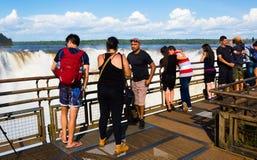 Observation deck on Garganta del Diablo waterfall on Iguazu Rive. IGUAZU NATIONAL PARK, ARGENTINA - FEBRUARY 16, 2017: Tourists on viewing platform of waterfall Stock Photos