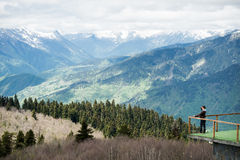 Observation deck on lookout, viewpoint in Alps mountains, Switzerland. Man standing and relaxing. Royalty Free Stock Photography