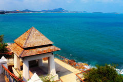 Observation deck overlooking the sea. An observation deck with a house overlooking the sea stock photo