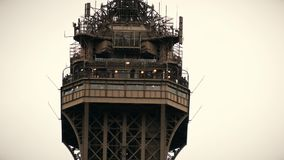 Observation deck on the top of the Eiffel tower in Paris, France. Telephoto lens shot. Observation deck on the top of the Eiffel tower in Paris, France royalty free stock photography