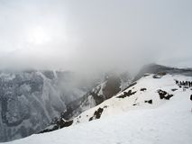 Observation deck for tourists along the Georgian military road in spring during heavy snowfall. Snowy landscape along the Georgian military road in spring during royalty free stock photography