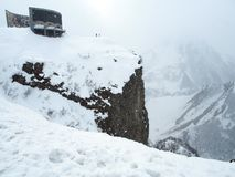 Observation deck for tourists along the Georgian military road in spring during heavy snowfall. Snowy landscape along the Georgian military road in spring during stock photos