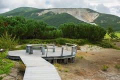 Observation deck at the Uzon Caldera. Kronotsky Nature Reserve on Kamchatka Peninsula. Kamchatka Peninsula, Russia - August 12, 2016: Observation deck at the royalty free stock photo