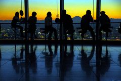 Observation deck viewpoint. People enjoying the view on Mount Fuji at sunset from the observation deck at Tokyo City View on top of the Roppongi Hills Skyscraper royalty free stock image