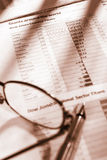 Observation of global economic growth. Glasses and pen over global economic growth sheet paper Stock Photo