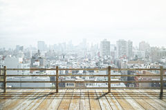 Observation platform city. Wooden observation platform with foggy city view. 3D Render Stock Photography