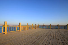 Observation platform by the lake under the blue sky stock photos