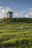 Observation point. A small hut used to observe and to guard the field Royalty Free Stock Photos