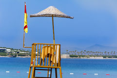 Observation tower on the beach with blue sky and blue water Stock Photos