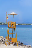 Observation tower on the beach with blue sky and blue water stock image