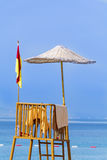 Observation tower on the beach with blue sky and blue water Royalty Free Stock Photo